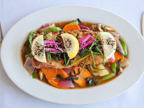 A delicious entree served with vegetables