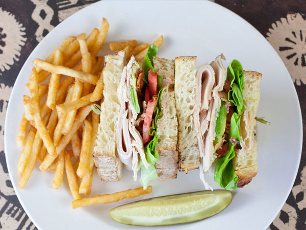 Turkey sandwich with fries and a pickle