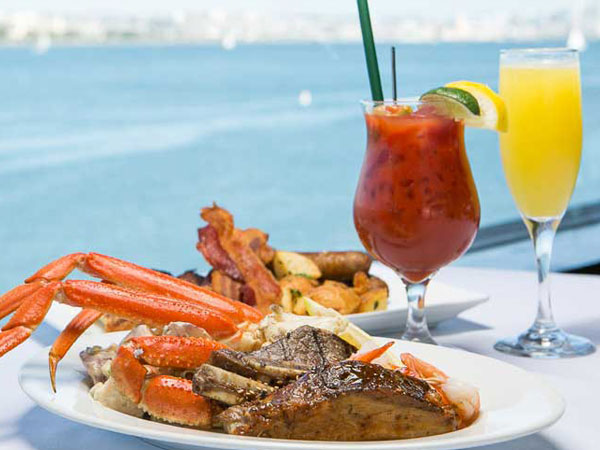 Steak and Lobster with various drinks and a view of the ocean