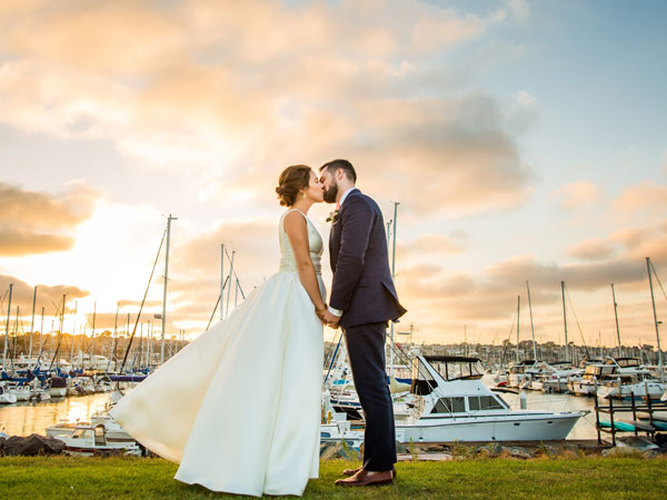A happy couple in front of the San Diego harbor