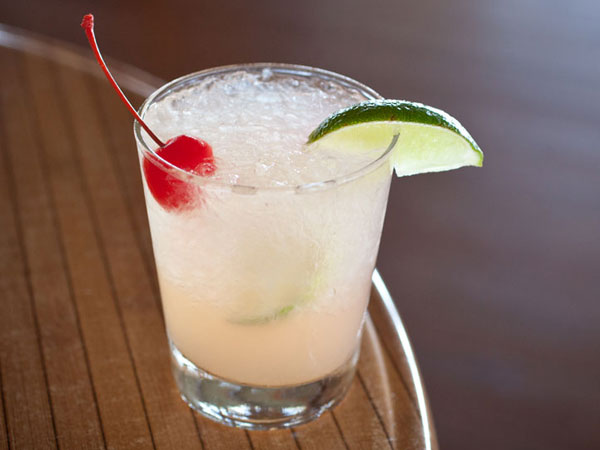 Drink with lime and cherry