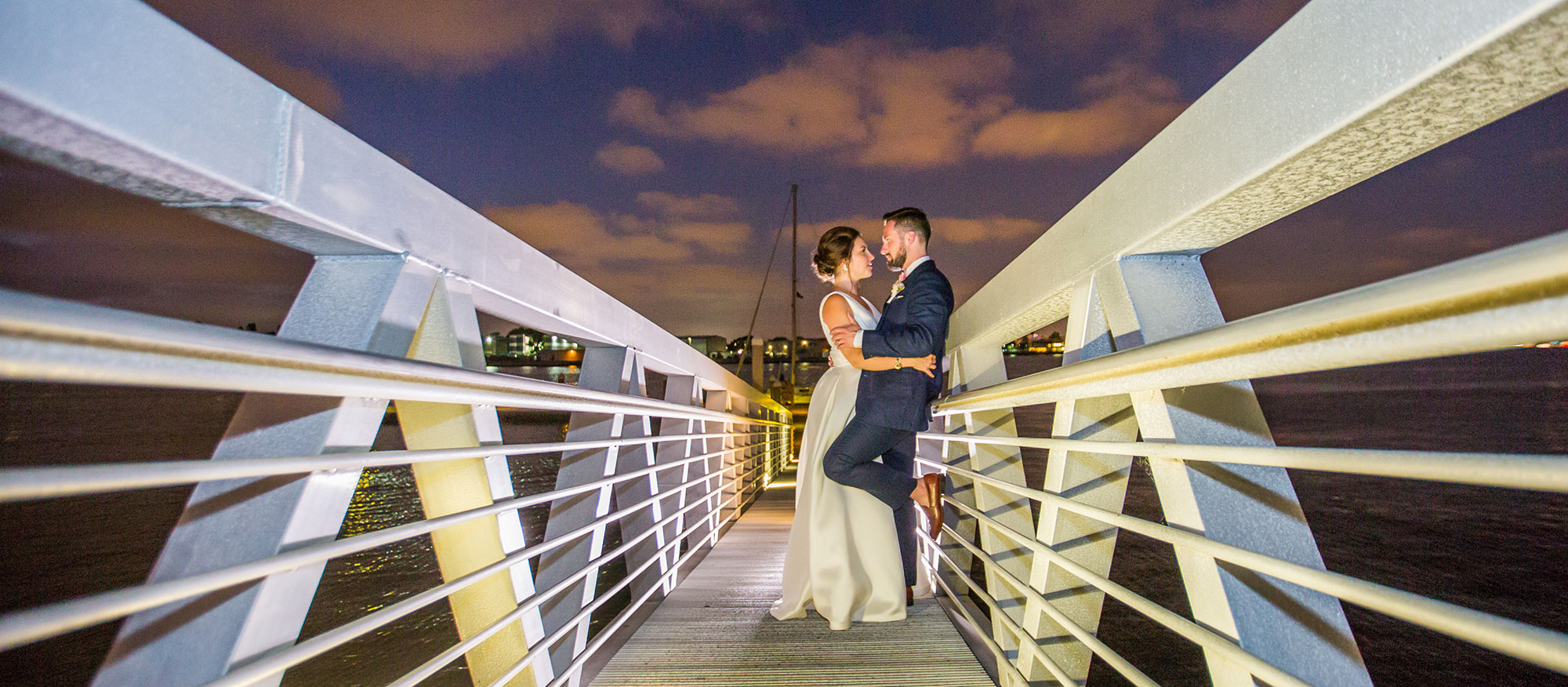 A happy couple standing on a dock