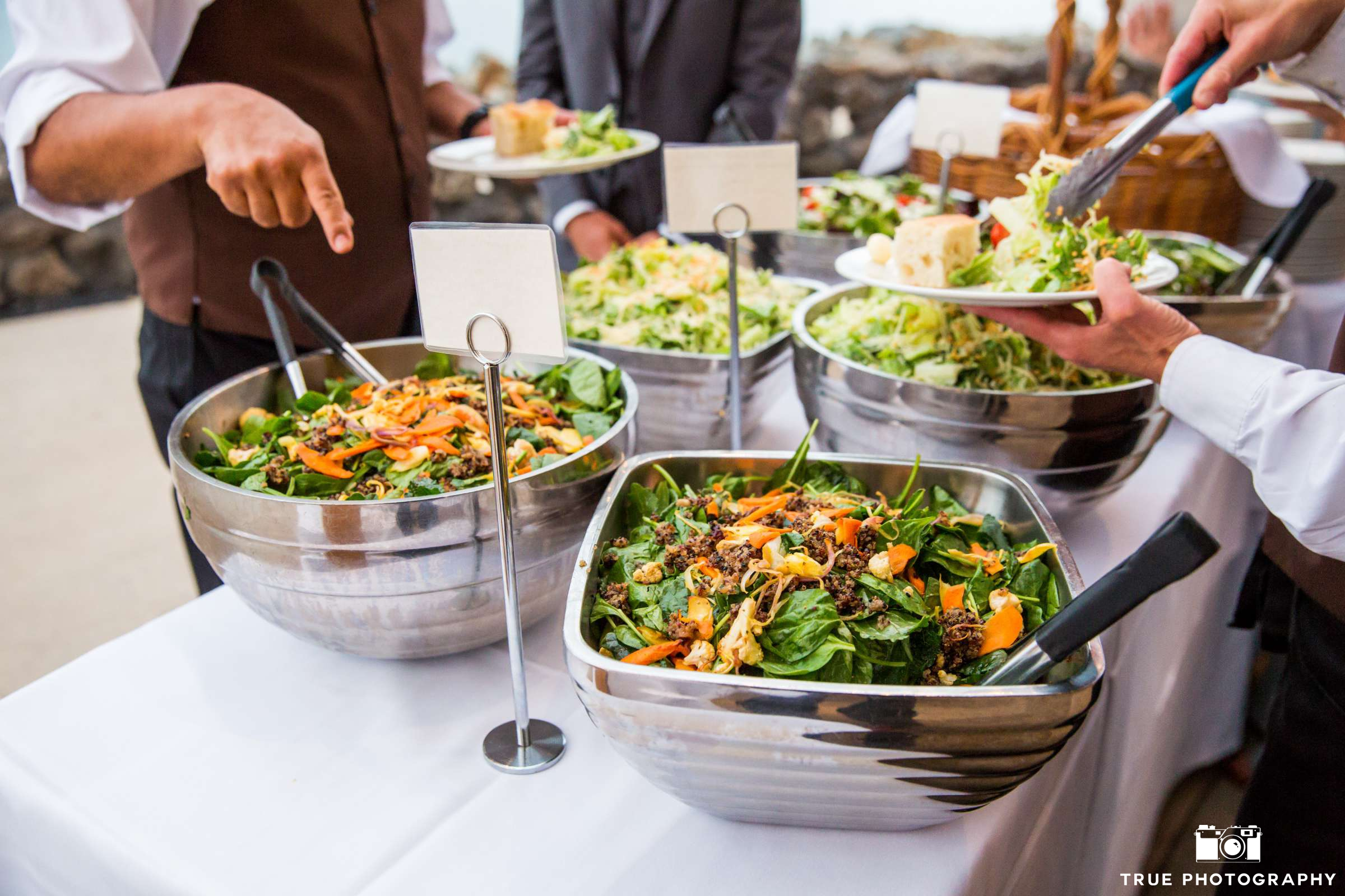 Various salads being served at an event