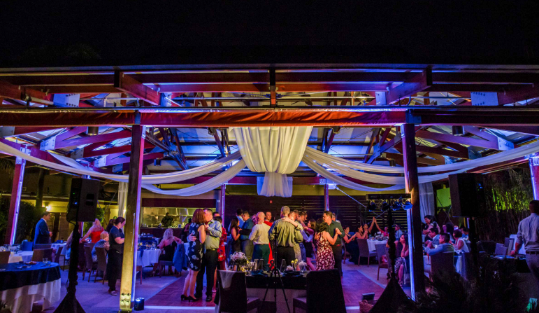 Outdoor wedding celebration with dancing