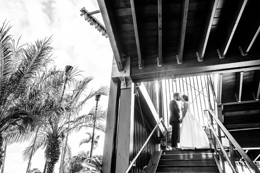 A happy couple walking out of Bali Hai after their wedding