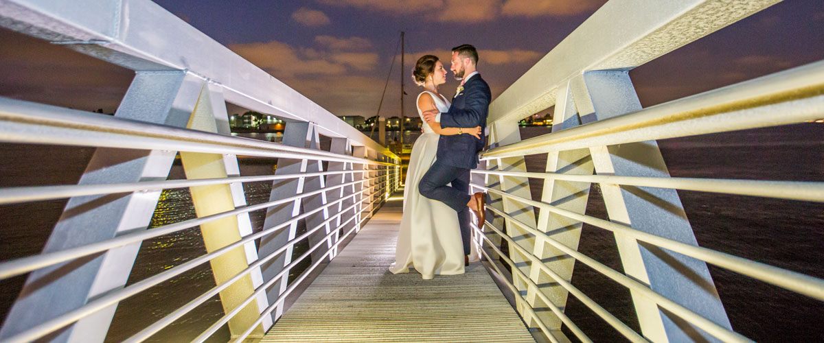 A married couple on a dock to the water
